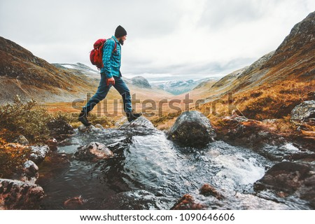 Man solo traveling backpacker hiking in scandinavian mountains active healthy lifestyle adventure journey vacations #1090646606
