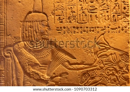 The ancient Egyptian art of hieroglyphs carving on stone,  display image of royalty with food, the civilization aged back to 1200 BC