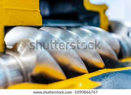 Cross section of the air compressor. Rotor of air screw compressor. Close-up photo. Shallow depth of field. #1090866767