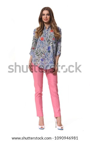 young caucasian business woman executive posing in summer casual print summer blouse and jeans high heels stiletto shoes full body length isolated on white #1090946981