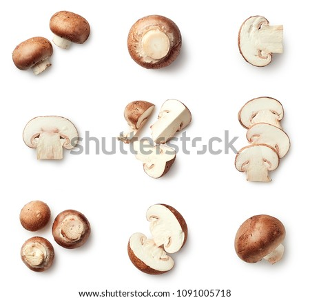 Set of fresh whole and sliced champignon mushrooms isolated on white background. Top view #1091005718