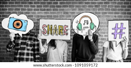 Friends holding up thought bubbles with social media concept icons #1091059172