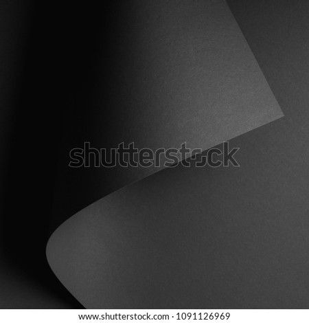 dark abstract background with black rolled paper sheet #1091126969