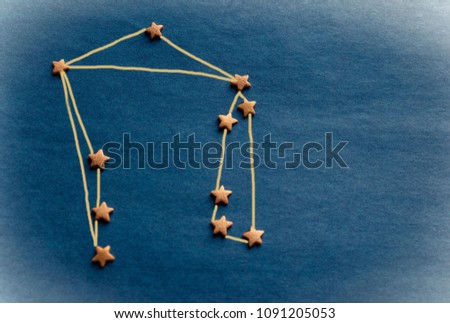 Small stars on a blue background, the constellation Libra. Zodiac, astrology, prediction, personal horoscope. Top view, vignetting. The picture is made by the author.