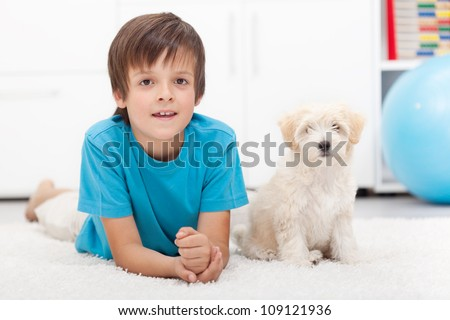 Young boy and his good behaving doggy together indoors #109121936