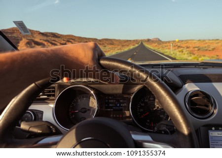 Arizona, USA- September 02, 2017: Inside of new silver Ford Mustang Cabriolet on the street in Arizona. men's hands on the steering wheel. #1091355374