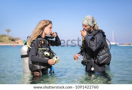 Scuba divers checking the air oxygen tank #1091422760