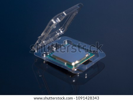 Central processing unit CPU processor microchip in the packaging box #1091428343