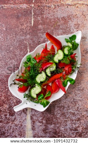Top view simple salad - sliced red tomatoes and green cucumbers with greenery on white plate, background, restaurant menu concept. Vegetarian, summer food, healthy lifestyle. #1091432732