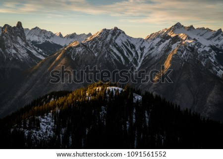 Snow covered mountains in Banff, Alberta captured during the winter. #1091561552