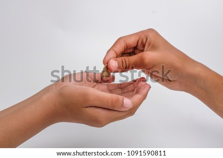 Close-up of a hand giving coin to another isolated on white background #1091590811