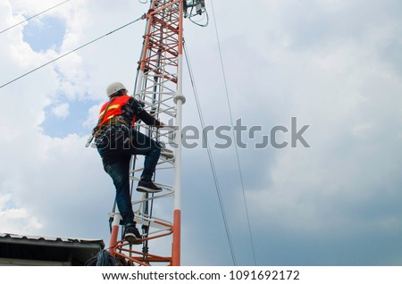 man climb tower to working,technician work high risk location,telecommunication tower. #1091692172