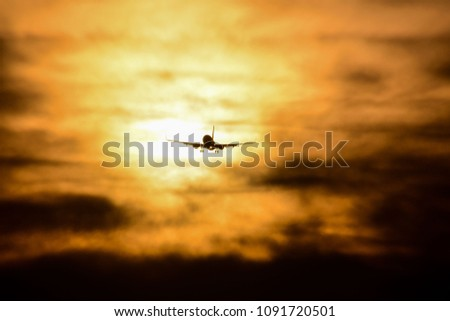 Photo picture Silhouette airplane flying on the sky