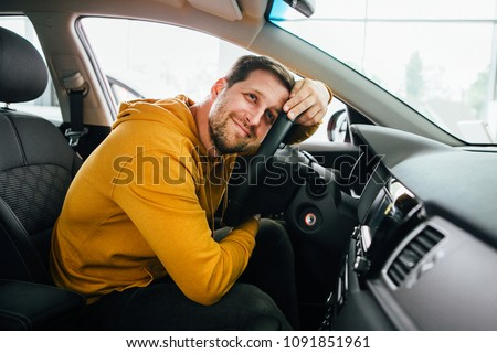 Man sits in his lovely car. #1091851961