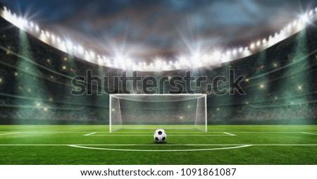 ball on the green field in soccer stadium. ready for game. penalty. Royalty-Free Stock Photo #1091861087