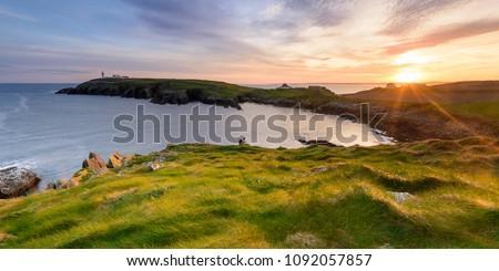 Galley Head Lighthouse at Sunset. Ardfield, Clonakilty, West Cork, Ireland. A real landmark on the Wild Atlantic Way. Royalty-Free Stock Photo #1092057857