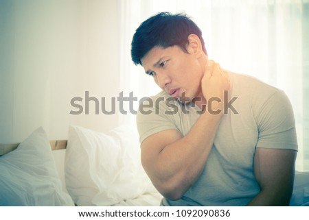 Male woke up having neck pain from sleeping #1092090836