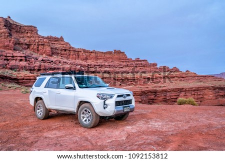 Moab , UT, USA - May 6, 2018:  Toyota 4runner SUV (2016 trail edition, stock vehicle without any off road modifacations)) on a desert trail before sunrise in the Moab area. #1092153812
