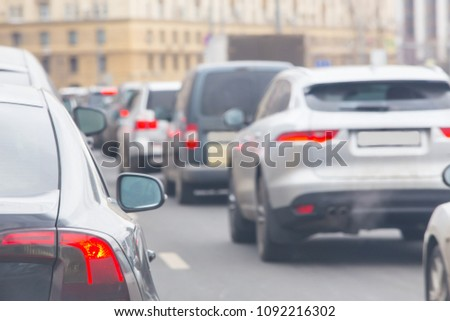 car in a big traffic jam. Back view. Blurred background. #1092216302