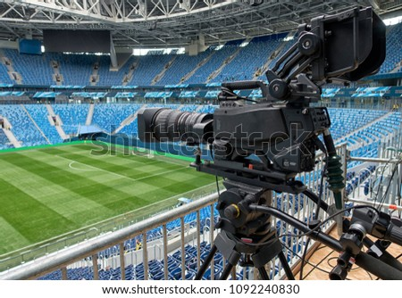 TV at the soccer. TV Professional studio digital video camera Royalty-Free Stock Photo #1092240830