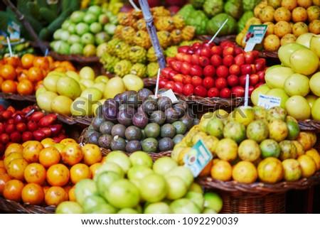 Many fresh and ripe exotic fruits on traditional farmer market Mercado dos Lavradores, Funchal, Madeira island, Portugal #1092290039