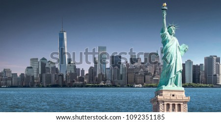 The Statue of Liberty with high-rise building in Lower Manhattan background, Landmarks of New York City, USA #1092351185