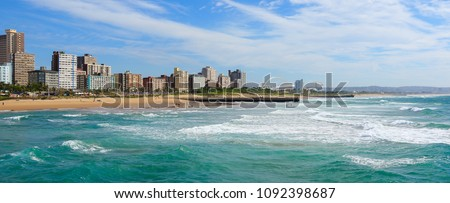 """Panoramic view of Durban's """"Golden Mile"""" beachfront as seen from from the Indian Ocean with waves, KwaZulu-Natal province of South Africa Royalty-Free Stock Photo #1092398687"""