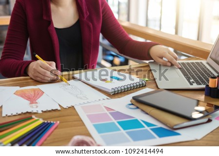 Young woman designer working as fashion designers at work with fashion sketches and color charts, profession and job occupation, Fashion Designer Stylish Concept. #1092414494