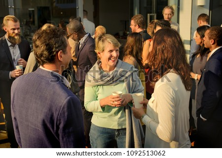 Diverse people mingling at an event Royalty-Free Stock Photo #1092513062