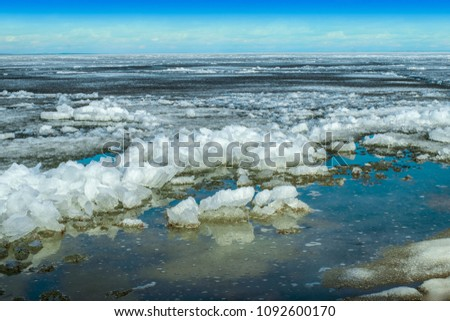 Melting dangerous ice on the river.The last spring ice floes float on water. #1092600170