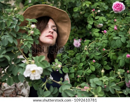 Close up portrait of a beautiful girl in a hat #1092610781