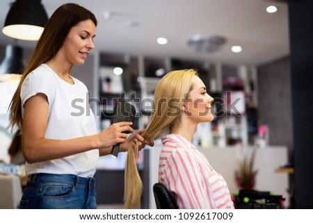 Happy woman at the hair salon #1092617009