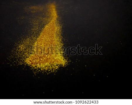 Glitter gold on black background #1092622433