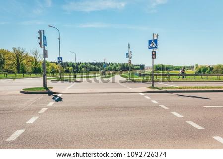 Urban pedestrian crossing with traffic lights. #1092726374