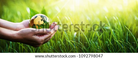 Green Planet in Your Hands. Save Earth. Environment Concept Royalty-Free Stock Photo #1092798047