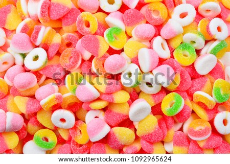 Assorted gummy candies. Top view. Jelly  sweets. Royalty-Free Stock Photo #1092965624