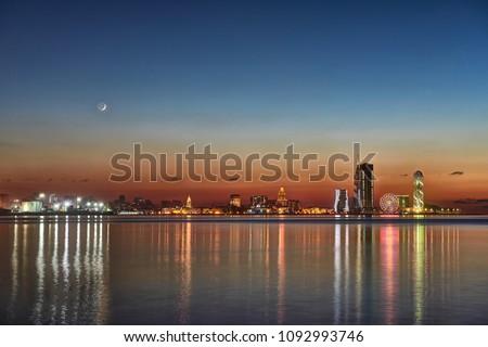 Beautiful night Cityscape, view of city Batumi at sunset from sea side. Night reflections of lights in Black Sea port of Batumi, capital of Adjara. Georgia. #1092993746