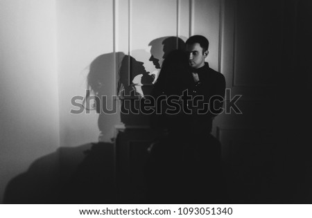Portait of a sensual, young couple relaxing in a luxurious apartment #1093051340