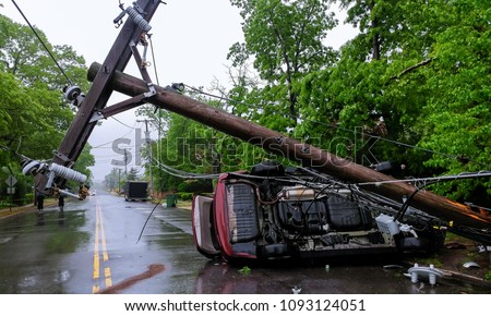 Car turned over after accident with crash electric pole after a severe storm Royalty-Free Stock Photo #1093124051