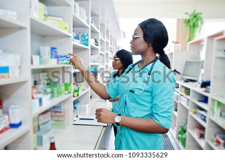 Two african american pharmacist working in drugstore at hospital pharmacy. African healthcare. #1093335629