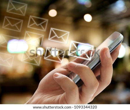 hand of a businessman holding a smartphone and have envelope symbol in Communications concept for design in your work Presentation. #1093344320