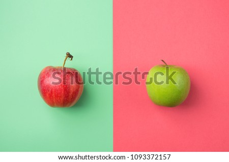 Ripe Organic Apples on Split Duotone Green Red Cherry Pink Background. Styled Creative Image. Vitamins Summer Vegan Fashion Concept. Food Poster with Copy Space