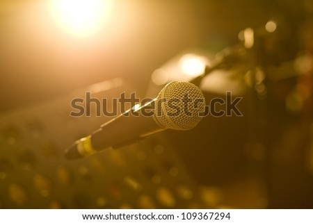 microphone with dramatic light in recording studio