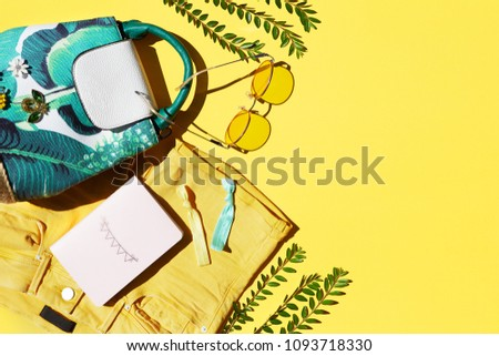 Summer fashion clothing and accessories on yellow background, trendy tropical pattern flat lay with copy space #1093718330
