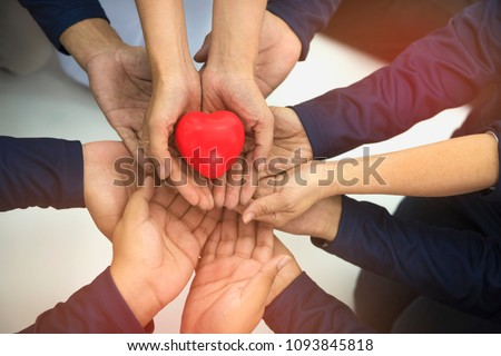 Group of hands holding red heart, health care, love, organ donation, family insurance and CSR concept #1093845818