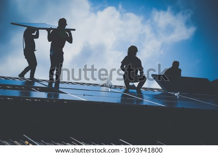 Installing a Solar Cell on a Roof, Shadow image Royalty-Free Stock Photo #1093941800