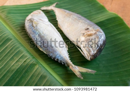 Mackerel fish on green banana leaves. #1093981472