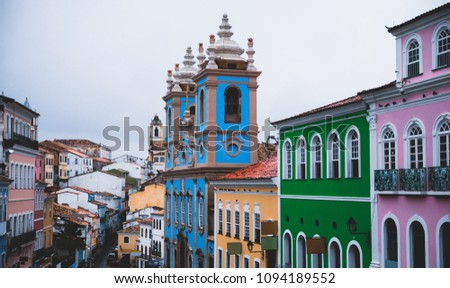 "Pelourinho (""Pillory""), is a historic neighborhood in western Salvador, Bahia, Brazil. It was the city's center during the Portuguese colonial period. There are some tourists looking the architecture."