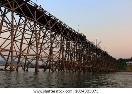 The longest wooden bridge at Sangkhlaburi and Mon Villagers in Thailand (Sunset and Silhouette) #1094305073