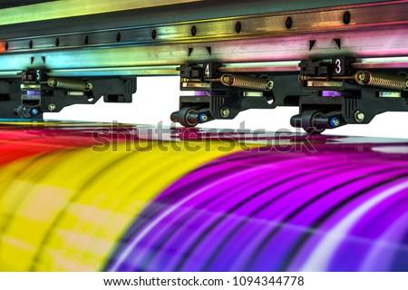 Large printer format inkjet working  Royalty-Free Stock Photo #1094344778